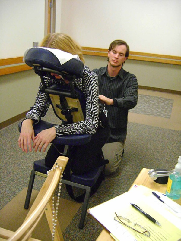image of Jered giving chair massage